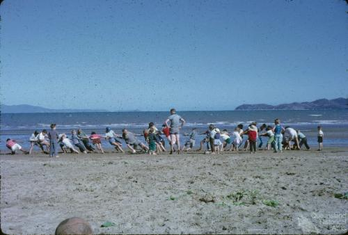 Sunday School picnic tug of war on the Strand, Townsville, 1962