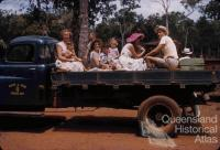 Travelling on Queensland Health & Home Affairs Dept truck, 1958