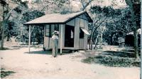 Elizabeth Coombs outside cabin on Hayman Island, 1938