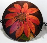 Poinsettia, poker-work decorated doyley press