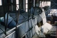 Unloading bulk sugar rail trucks, Mackay, 1958