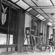 Repairing broken windows, American canteen, Brisbane 1942