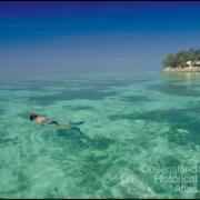 A snorkeller views the shallow corals at Heron Island, 1997